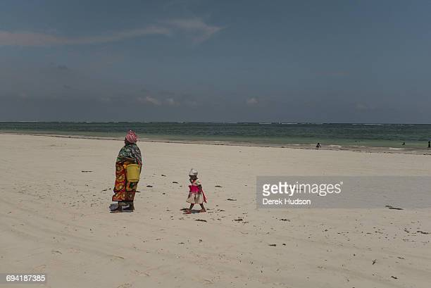 A grandmother and her grandchild walking on Diani Beach Diani Beach is a major resort on the Indian Ocean coast of Kenya eastern Africa located 30...