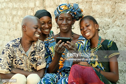 A grandmother and her grandchildren enjoying