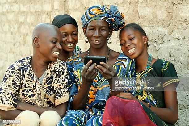 A grandmother and her grandchildren enjoying