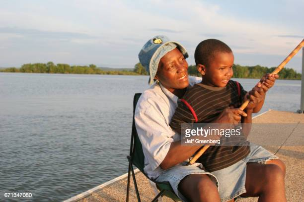 A grandmother and her grandson fishing in Chattahoochee River
