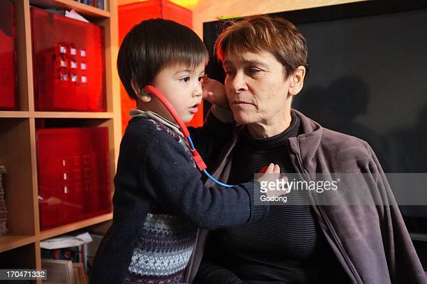 Grandmother and son playing doctor France
