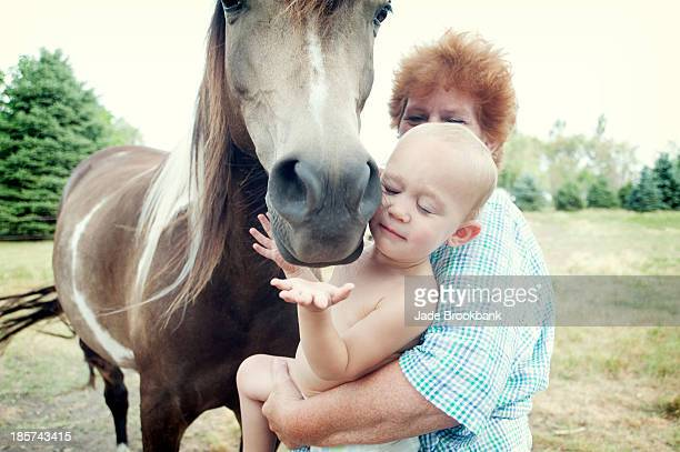Grandmother and toddler with horse