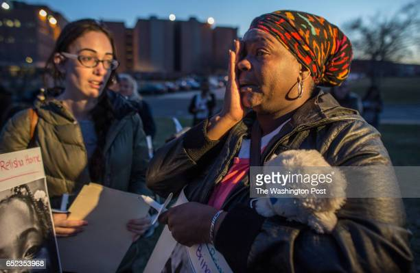 Grandmother Belinda Wheeler with the teddy bear of missing Relisha Rudd at a vigil outside the Homeless Children's Playtime Project for missing...