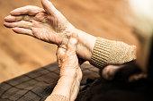 Grandmother checking pulse on wrist