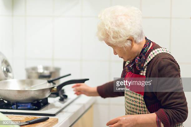 Grandmother cooking in kitchen