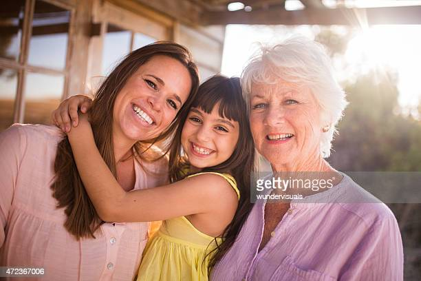 Grandmother, daughter and granddaughter posing for a portrait