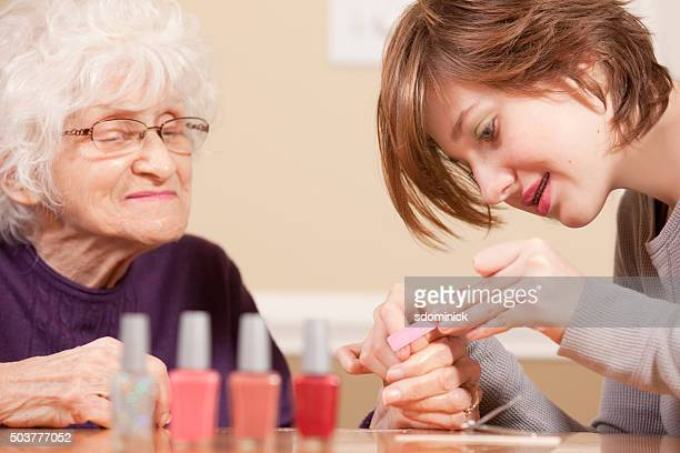 Grandmother Enjoying Manicure From Granddaughter