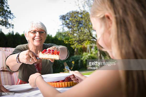 Grandmother handing pie