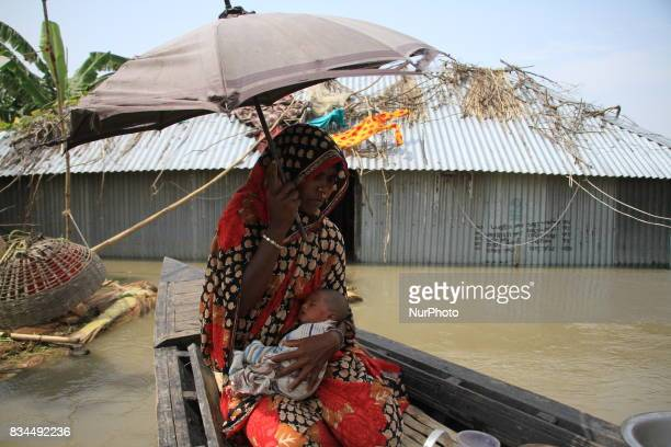 A grandmother hold new born baby in Kurigram northern Bangladesh on August 16 2017 More than 50 people have died in flood and natural disasters and...