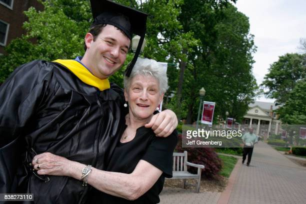 A grandmother hugs her grandson on his graduation day at Roanoke College