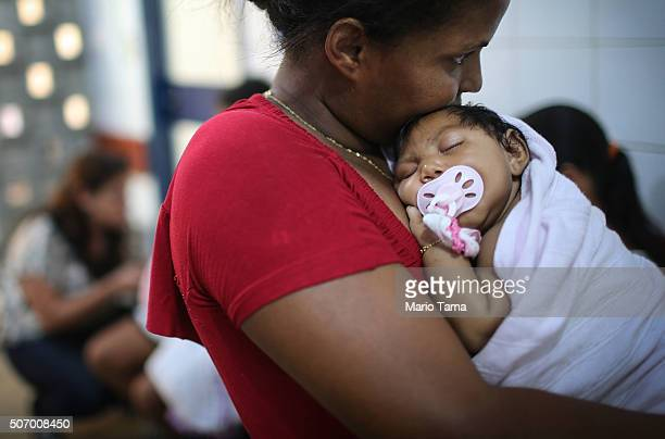 Grandmother Ivalda Caetano holds Ludmilla Hadassa Dias de Vasconcelos who has microcephaly at Oswald Cruz hospital on January 26 2016 in Recife...