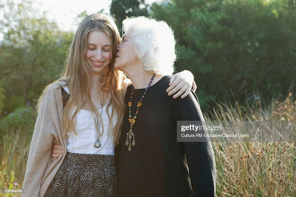 Grandmother kissing granddaughter : Stock Photo