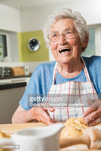 Grandmother kneading dough