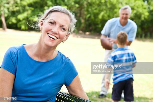 Grandmother Laughing While Grandson plays with Granddad