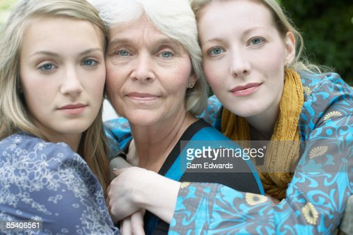 Grandmother, mother and daughter hugging