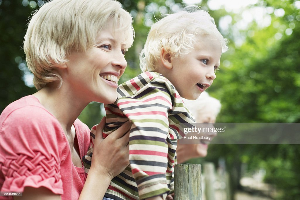 Grandmother, mother and son enjoying park : Stock Photo