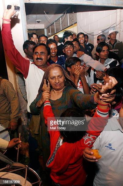 Grandmother of cricketer Parvinder Awana along with other family members celebrate his selection in the Indian cricket test team on 9th December 2012