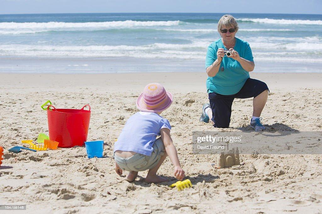 Grandmother Photographing Grandchild : Stock Photo