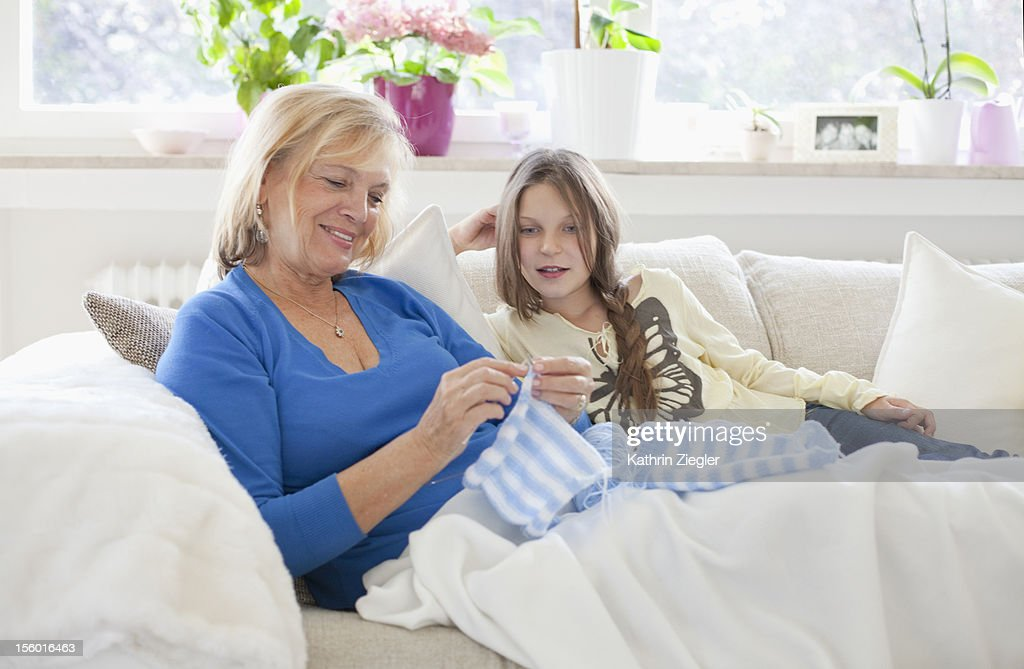 grandmother showing granddaughter how to knit : Stock Photo