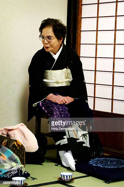 A grandmother waiting for a granddaughter's traditional Japanese wedding ceremony to start