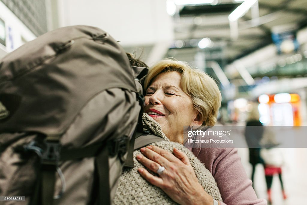 Grandmother Welcoming Young Traveller