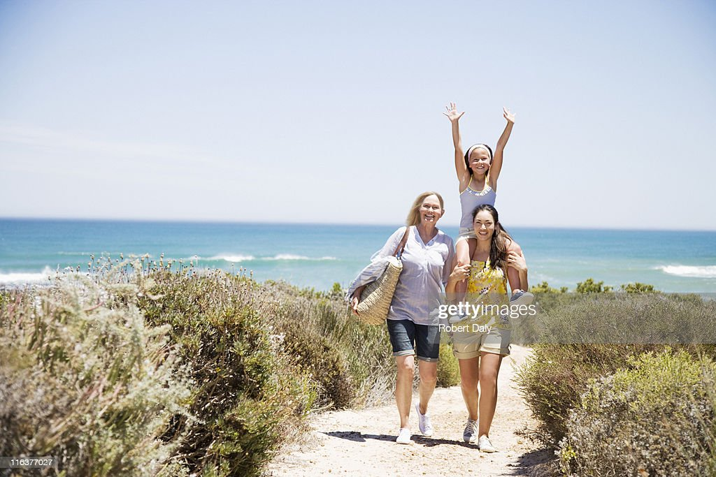 Grandmother with daughter and granddaughter on beach path : Stock Photo
