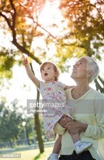 Grandmother with grand daughter in park
