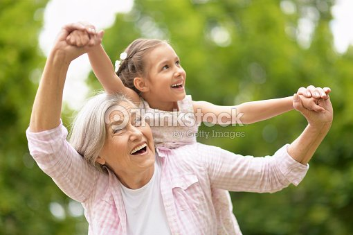 Grandmother with granddaughter  in park : Stock Photo
