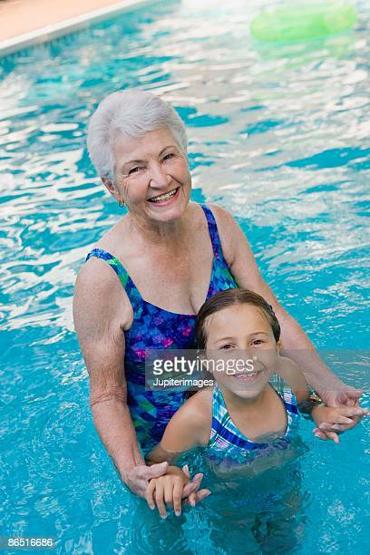Grandmother with granddaughter in swimming pool