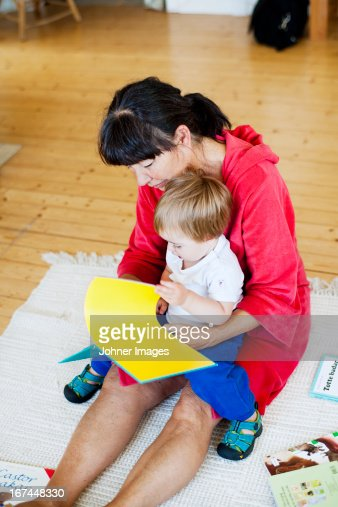 Grandmother with grandson reading book : Stock Photo