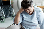 Grandmother with headache fell to the floor in the nursing house