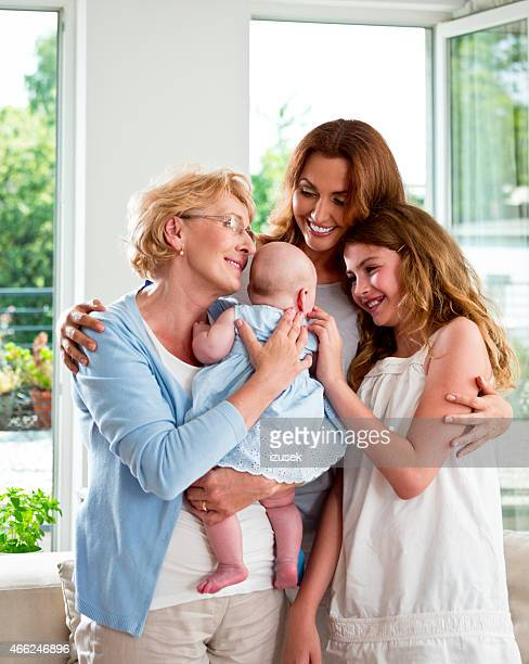 Grandmother with her granddaughters and daughter