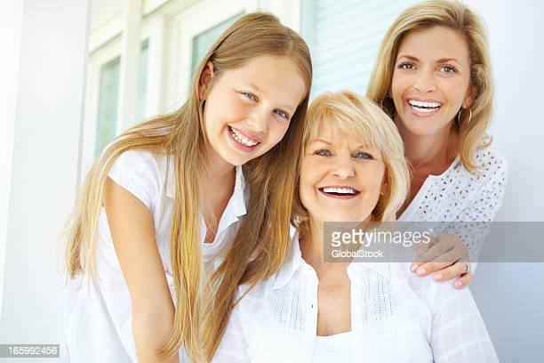 Grandmother with mature daughter and granddaughter smiling