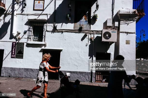 BARRAMEDA CADIZ ANDALUCíA SPAIN Grandmothers pushing baby strollers while walking on street