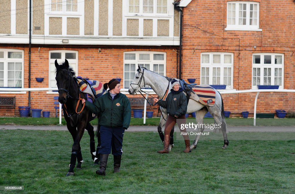 Grandouet (L) and Simonsig are led round before returning to Lambourn due to frosty ground conditions at Newbury racecourse on March 04, 2013 in Newbury, England.