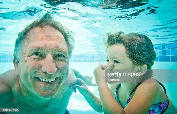 Grandpa and Granddaughter Underwater