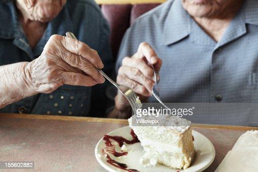 Grandpa and Grandma Sharing Cake