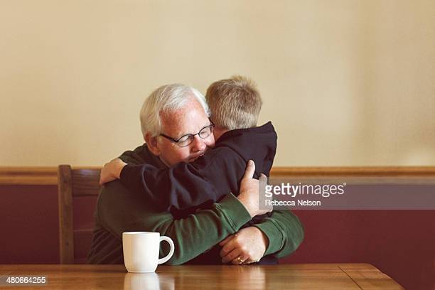 Grandpa and grandson embracing