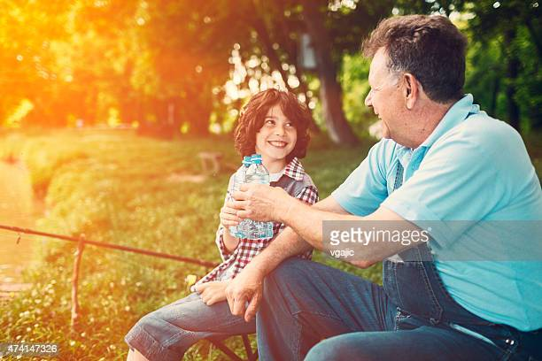 Grandpa and grandson fishing together.