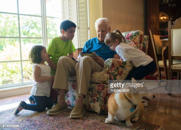 Grandpa and kids with a digital tablet