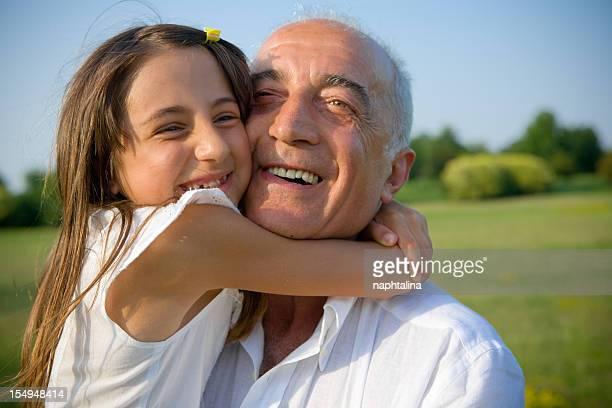 Grandpa and niece sharing big hug