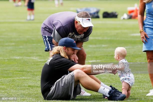 Grandpa New England Patriots head coach Bill Belichick with son New England Patriots safeties coach Steve Belichick and granddaughter during Patriots...