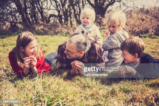 Grandpa with his Grandchildren : Stock Photo