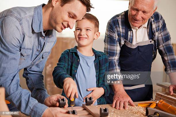 Grandpa with son and grandson at woodshop