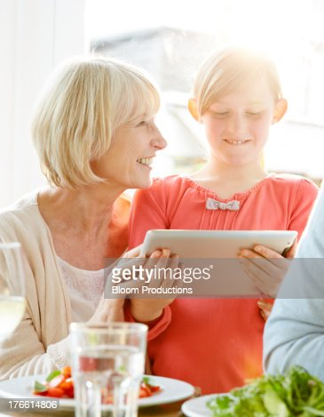 Grandparent and Grandchild usin a tablet : Stock Photo