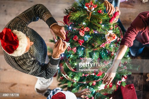 grandparent making the christmas tree