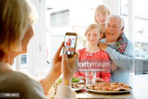 Grandparent taking a picture of grandchildren