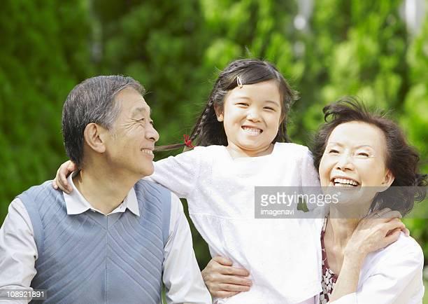 Grandparents and grandchild smiling