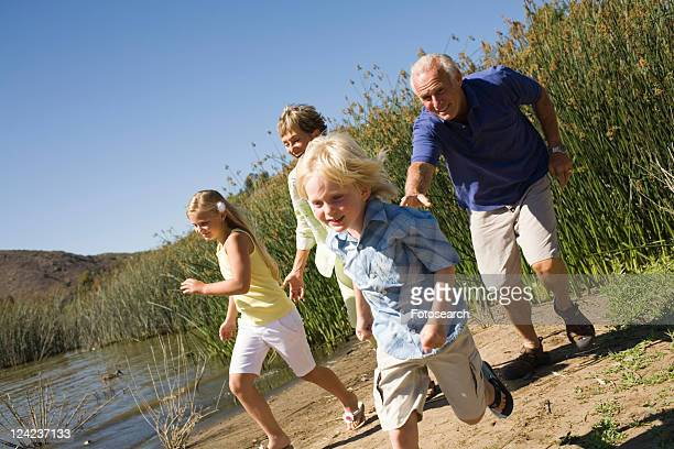 Grandparents and grandchildren by lake