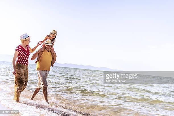 Grandparents And Grandchildren Enjoying Beach Holiday